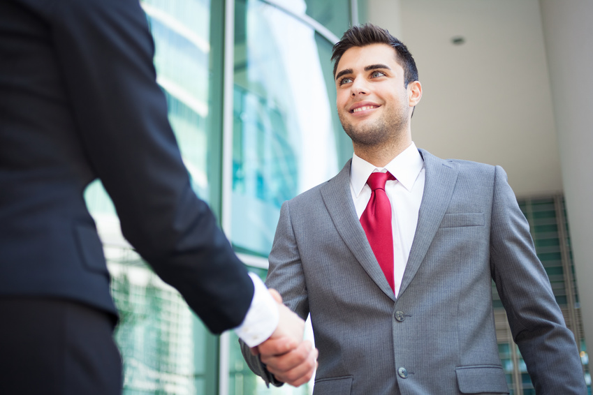 Young business people shaking hands